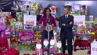 Obama The 'Big Elf' Sorts Toys For Little Girls and Boys