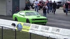 Tesla Model S P85D Sets 1-4 Mile World Record While Challenger Hellcat Goes up in Smoke Drag Racing